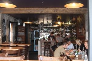 Breezy, yet cozy bar area
